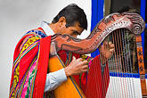 horizontal stock photography | Peru, Cuzco, Man playing Andean Harp, image id 8-761-839