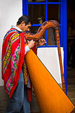 vertical stock photography | Peru, Cuzco, Man playing Andean Harp, image id 8-761-856