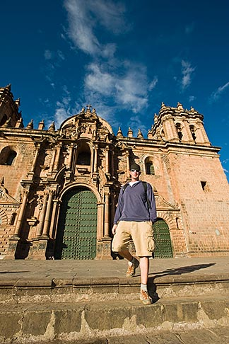 image 8-761-988 Peru, Cuzco, Tourist descending steps in front of Cuzco Cathedral, low angle view
