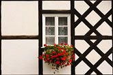 windowpane stock photography | Poland, Jelenia Gora, Window and flowerbox, image id 4-960-1243