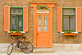 bicycle outside house stock photography | Canada, Quebec City, House in Old Quarter, with bicycle, image id 5-750-412