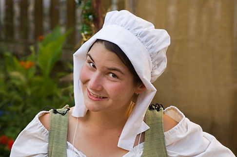 5-750-8200  stock photo of Canada, Quebec City, Fetes de la Nouvelle France, Woman in bonnet