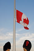 red headdress stock photography | Canada, Quebec City, Canadian flag and Changing of the Guard, image id 5-750-9789