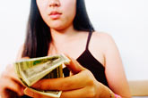 cash stock photography | Portraits, Woman counting money, image id S5-143-1224