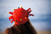 red headdress stock photography | California, San Francisco, Aquatic Park, woman with hat, image id 3-1012-95