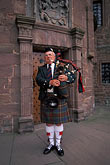 castle stock photography | Scotland, Angus, Glamis Castle, bagpiper, image id 1-521-97