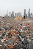 rubble stock photography | China, Shanghai, Empty lot with Pudong skyline, image id 7-620-3528