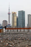 rubble stock photography | China, Shanghai, Empty lot with Pudong skyline, image id 7-620-3542