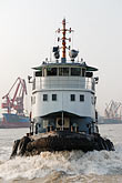 vertical stock photography | China, Shanghai, Tug on the Huangpu River, image id 7-620-4098