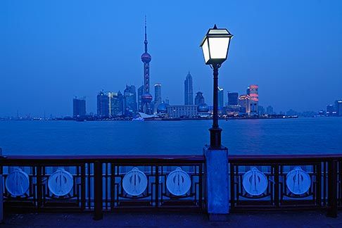 7-620-4173  stock photo of China, Shanghai, Pudong skyline and the Bund Promenade at night