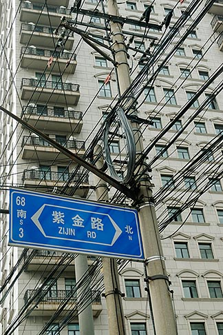image 7-620-4195 China, Shanghai, Electrical wires and apartment building