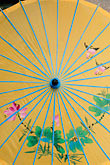 vertical stock photography | China, Shanghai, Yellow parasol with floral design, image id 7-620-4397