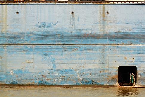 image 7-620-9305 China, Shanghai, Workman on cargo ship