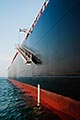 hull of oli tanker with boarding ramp stock photography | Shipping, Hull of Oli Tanker with boarding ramp, image id 7-677-8920
