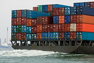 7-678-5285  stock photo of Shipping, Containers stacked on container ship, view from stern