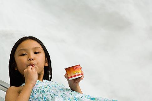 image 7-680-4514 Singapore, Young girl eating icecream