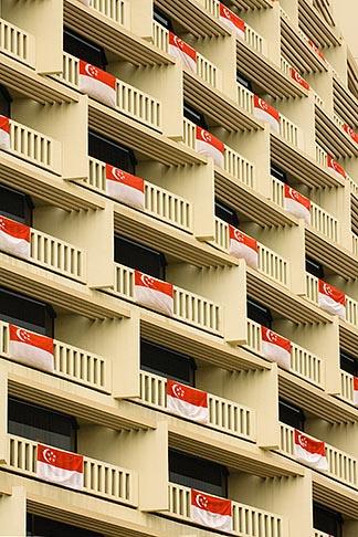image 7-680-4567 Singapore, Hotel balconies draped with Singapore flag