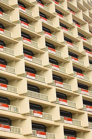 image 7-680-4569 Singapore, Hotel balconies draped with Singapore flag