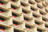horizontal stock photography | Singapore, Hotel balconies draped with Singapore flag, image id 7-680-4570