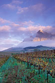 early morning mist stock photography | South Africa, Franschhoek, Sunrise on Groot Drakensteinberg, image id 1-415-72