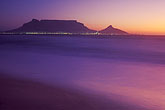 shore stock photography | South Africa, Western Cape, Table Mountain at dusk from Bloubergstrand, image id 5-475-16