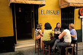 woman seated outside stock photography | Spain, Seville, Cafe, image id 1-254-14
