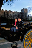 one young woman stock photography | Spain, Seville, Couple in horse-drawn carriage, image id 1-257-11
