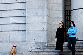 person stock photography | Spain, Madrid, Nun and woman leaving a church, image id S4-545-864