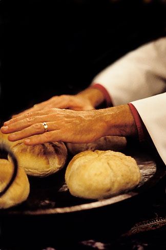 image 5-568-18 California, San Francisco, Bishops hands blessing bread,