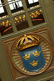 vertical stock photography | Sweden, G�teborg, Train station, Swedish coat of arms, image id 5-700-5830