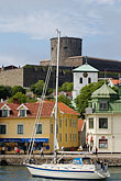 vertical stock photography | Sweden, Marstrand, Sailboat in harbor, image id 5-710-2371