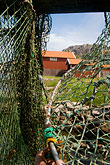 vertical stock photography | Sweden, West Sweden, Fishing nets, image id 5-710-2511