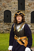 one stock photography | Sweden, Marstrand, Carlsten Fortress, soldier and guide, image id 5-710-5388