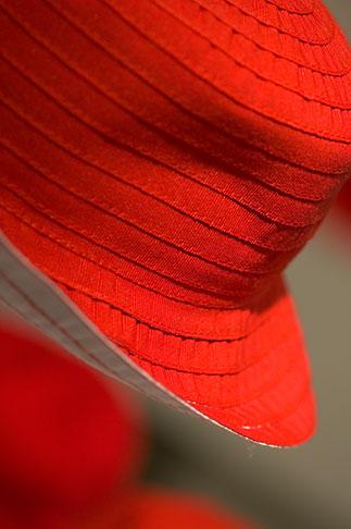 image 5-720-3967 Sweden, Stockholm, Red hat in shop