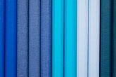 white background stock photography | Still life, Blue Cloth bound notebooks, image id 5-720-4052