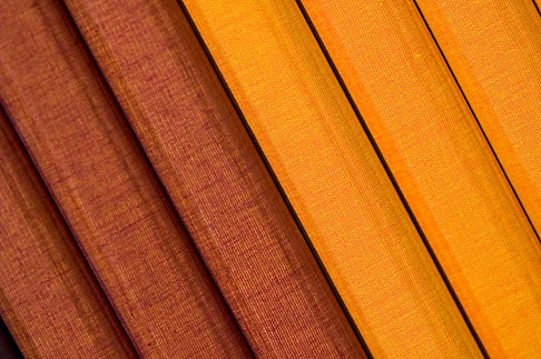 image 5-720-4061 Still life, Yellow and brown cloth bound notebooks