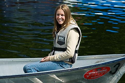 image 5-720-6700 Sweden, Stockholm, Woman in boat
