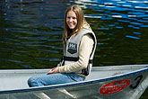 one woman only stock photography | Sweden, Stockholm, Woman in boat, image id 5-720-6700
