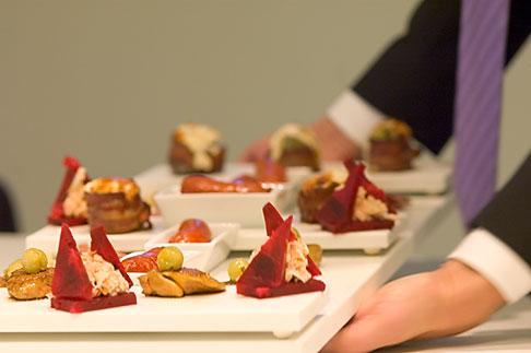 image 5-720-6883 Sweden, Stockholm, Waiter serving platter of bread
