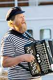 head covering stock photography | Sweden, Stockholm, Accordian player, image id 5-720-7711