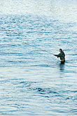 one person stock photography | Sweden, Stockholm, Fishing in the Norrstrom, image id 5-720-7792