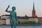 architecture stock photography | Sweden, Stockholm, Song statue, Stadshuset, bronze by Carl Eldh, image id 5-720-7851