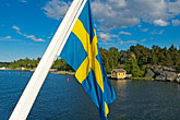 boat stock photography | Sweden, Stockholm Archipelago, Swedish flag, image id 5-730-3317