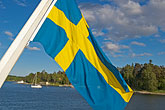 sunlight stock photography | Sweden, Stockholm Archipelago, Swedish flag, image id 5-730-3320