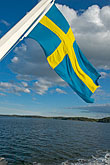 sunlight stock photography | Sweden, Stockholm Archipelago, Swedish flag, image id 5-730-3328