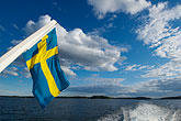cloudy stock photography | Sweden, Stockholm Archipelago, Swedish flag, image id 5-730-3331