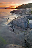 sweden grinda island stock photography | Sweden, Grinda Island, Sunset on rocks, image id 5-730-3394