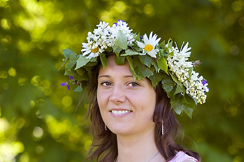 image 5-730-3444 Sweden, Grinda Island, Woman wih flower wreath for midsummer