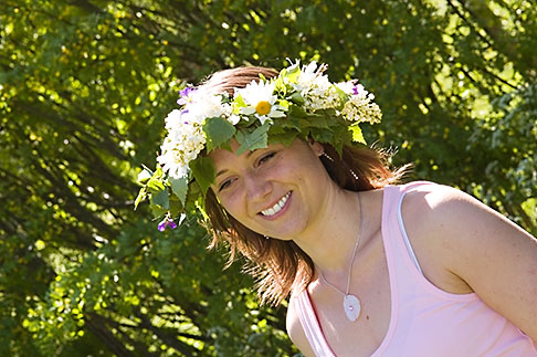 image 5-730-3450 Sweden, Grinda Island, Woman wih flower wreath for midsummer