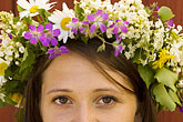 woman viewing garden stock photography | Sweden, Grinda Island, Woman wih flower wreath for midsummer, image id 5-730-3551